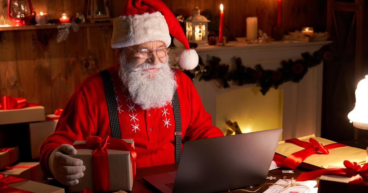 Santa Checking His Stock Portfolio in the Workshop